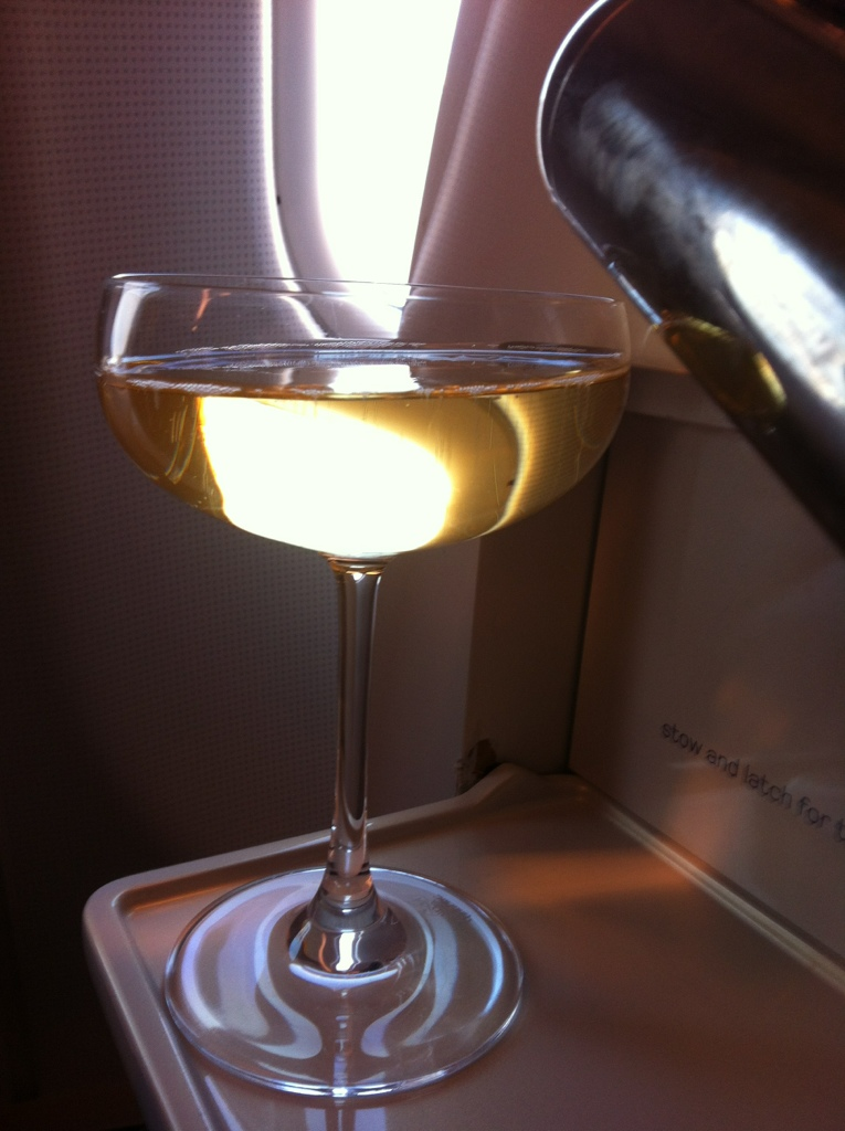 Virgin Atlantic … The retro champagne glass ….. Ching Ching … Cheers darling and here's to a safe flight with the best entertainment selection of any airline !!